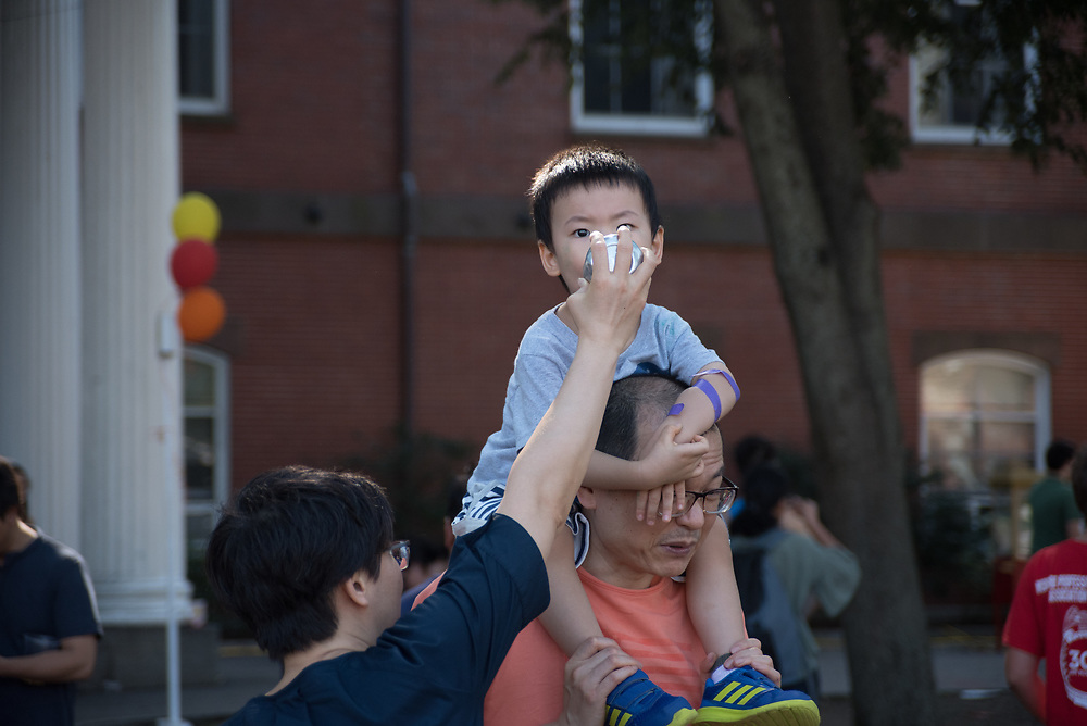 9/24/17 – Medford/Somerville, MA – Parents feed water to their child during Tufts Community Day on September 24. (Seohyun Shim / The Tufts Daily)