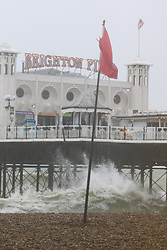 © Licensed to London News Pictures. 02/06/2015. Brighton, UK. Brighton and the South Coast are being battered by strong wind and big waves. The Lifeguard Service has raised the red flag advising people to stay out the water. today June 2nd 2015. Photo credit : Hugo Michiels/LNP