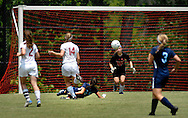 26 MAY 2012 -- TOWN & COUNTRY, Mo. -- Visitation Academy soccer goalie Grace Forthaus prepares to make a save after a shot by St. Dominic High School player Haley Ennis (21) during the MSHSAA Class 2 girls' soccer quarterfinals at Visitation Saturday, May 26, 2012. St. Dominic topped the Vivettes 8-1 to advance to Friday's semifinals against Helias Catholic High School at Blue Springs South High School. Photo © copyright 2012 Sid Hastings.