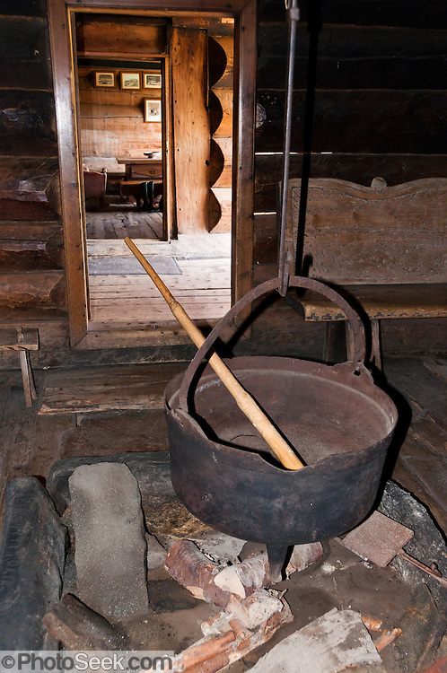 Old cauldron and stirring stick over fireplace. Visit the farm museum of Rygnestadtunet (at Nordigard, in Nørdre Rygnestad, near Valle, Setesdal, Aust-Agder, Norway) to admire a unique 1590 three-story storehouse, a farmhouse with open-hearth room dating from before the Black Death (1349-50), and 15th century painted textiles.