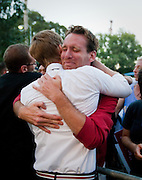 Dustin Lance Black, an American screenwriter, director, film and television producer, and LGBT rights activist, embraces a supporter of Gay Marriage during a rally after Prop. 8 was overturned.