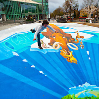 . LONDON, ENGLAND - NOVEMBER 23: Artist Edgar Muller's 3D pavement artwork is unveiled at Westfield on November 23, 2009 in London, England. Muller created the largest 3D design, inspired by the movie Ice Age 3, beating his previous Guinness World Record...***Agreed Fee's Apply To All Image Use***.Marco Secchi /Xianpix. tel +44 (0) 771 7298571. e-mail ms@msecchi.com .www.marcosecchi.com