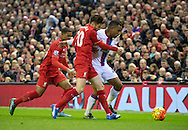 Jason Puncheon of Crystal Palace (right) looks to shrug off Adam Lallana (centre) and Jordon Ibe of Liverpool (left) during the Barclays Premier League match at Anfield, Liverpool<br /> Picture by Russell Hart/Focus Images Ltd 07791 688 420<br /> 08/11/2015