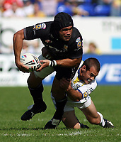 Photo: Paul Thomas.<br /> Warrington Wolves v Hull FC. Engage Super League. 08/09/2006.<br /> <br /> Hull's Sid Domic (L) gets tackled byMike Sullivan.