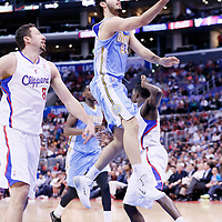 15 April 2014: Denver Nuggets guard Evan Fournier (94) goes for the lay up past Los Angeles Clippers forward Hedo Turkoglu (8) during the Los Angeles Clippers 117-105 victory over the Denver Nuggets at the Staples Center, Los Angeles, California, USA.