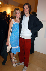 GRACE PILKINGTON and HENRY HUDSON at a party to celebrate the opening of Photo-London 2006 at Burlington Gardens, London W1 on 17th May 2006.<br />