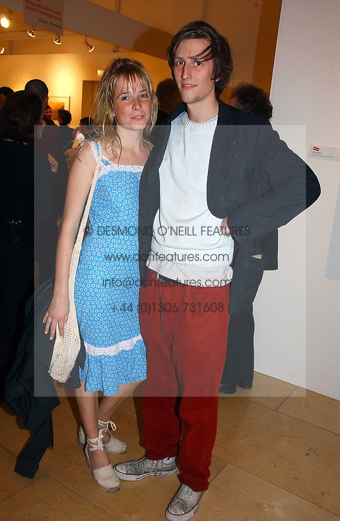 GRACE PILKINGTON and HENRY HUDSON at a party to celebrate the opening of Photo-London 2006 at Burlington Gardens, London W1 on 17th May 2006.<br /><br />NON EXCLUSIVE - WORLD RIGHTS