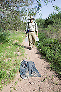 No More Deaths volunteer Michael McPherson walks a main trail used by migrants that have crossed the Mexico border on their way to Phoenix.