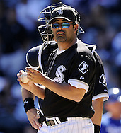 CHICAGO - SEPTEMBER 12:  Manager Ozzie Guillen #13 of the Chicago White Sox makes a pitching change during the game against the Kansas City Royals on September 12, 2010 at U.S. Cellular Field in Chicago, Illinois.  The White Sox defeated the Royals 12-6.  (Photo by Ron Vesely)