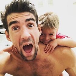 """Michael Phelps releases a photo on Instagram with the following caption: """"@boomerrphelps is climbing on me like he\u2019s a \ud83d\udc12. Ahhhhh WATCH OUT!!!"""". Photo Credit: Instagram *** No USA Distribution *** For Editorial Use Only *** Not to be Published in Books or Photo Books ***  Please note: Fees charged by the agency are for the agency's services only, and do not, nor are they intended to, convey to the user any ownership of Copyright or License in the material. The agency does not claim any ownership including but not limited to Copyright or License in the attached material. By publishing this material you expressly agree to indemnify and to hold the agency and its directors, shareholders and employees harmless from any loss, claims, damages, demands, expenses (including legal fees), or any causes of action or allegation against the agency arising out of or connected in any way with publication of the material."""