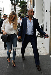EXCLUSIVE: Yankees' iconic former captain Derek Jeter attends a press conference to announce that he is now officially the CEO of the Miami Marlins. Jeter was wearing a blue suit as he stopped his car to sign autographs after the event, and seated beside him was Marlins' principle owner Bruce Sherman. His wife, Hannah Jeter, who also attended the news conference, was seen arriving back to their hotel in a black dress. The Sports Illustrated cover model gave birth to the couple's first daughter, Bella Raine, less than two months ago. Later, The trio was seen heading out to a celebratory dinner at Komodo Restaurant, where they dined in a private space away from onlookers. Hannah changed into a silky white blouse and skin tight jeans while Derek opted to stay in the blue suit he wore earlier in the day. Derek held the door for hannah as they entered the eatery, and the happy couple held hands as they left later. 03 Oct 2017 Pictured: Derek Jeter; Hannah Jeter. Photo credit: MEGA TheMegaAgency.com +1 888 505 6342