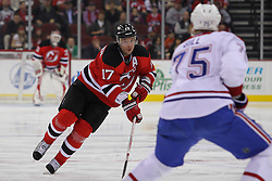 Feb 2; Newark, NJ, USA; New Jersey Devils left wing Ilya Kovalchuk (17) skates with the puck while being defended by Montreal Canadiens defenseman Hal Gill (75) during the second period at the Prudential Center.