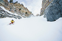 Andrew McLean skiing a steep couloir in the Wasatch Mountains, Utah.