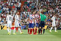Atletico de Madrid´s Godin, Mandjukic and Gabi argue with the referee during 2014 Supercopa de España `Spain Supercup´ at Santiago Bernabeu stadium. August 19, 2014. (ALTERPHOTOS/Victor Blanco)
