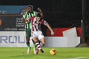 Ade Azeez of AFC Wimbledon and Jordan Moore-Taylor of Exeter City during the Sky Bet League 2 match between Exeter City and AFC Wimbledon at St James' Park, Exeter, England on 28 December 2015. Photo by Stuart Butcher.