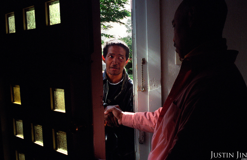 A junky arrives at the Amsterdam men's rehab home for the first time...Victory Outreach, a controversial church started in Los Angeles in 1967, is spreading to Europe via the Netherlands. It builds its membership among junkies, prostitutes and criminals. ..Photo taken in the Netherlands in 2002. The picture is part of a photo and text documentary by Justin Jin. For more information, email justin@justinjin.com