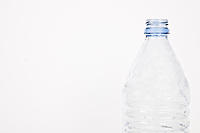 Close-up view of empty plastic bottle over white background