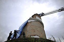 August 1, 2018 - Kathmandu, NP, Nepal - Firefighters along with the staff of Kathmandu Metropolitan City arranging tarpaulin to cover historic tower Dharahara to protect from rain and other source of damage at Sundhara, Kathmandu, Nepal on Wednesday, August 1, 2018. The Deputy Mayor of Kathmandu Metropolitan City, Hari Prabha Khadki initiate the event to protect historic tower Dharahara. Most of the centuries-old monuments and houses were completely or partially destroyed in the 7.8 magnitude earthquake in Nepal killed over 9,000 people, leaving thousands injured. (Credit Image: © Narayan Maharjan/NurPhoto via ZUMA Press)