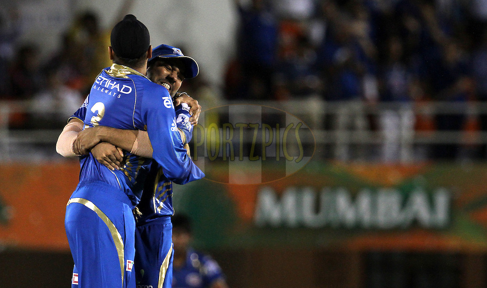 Harbhajan Singh of the Mumbai Indians and Rohit Sharma captain of the Mumbai Indians  celebrates the wicket of Dwayne Smith of The Chennai Superkings during the eliminator match of the Pepsi Indian Premier League Season 2014 between the Chennai Superkings and the Mumbai Indians held at the Brabourne Stadium, Mumbai, India on the 28th May  2014<br /> <br /> Photo by Vipin Pawar / IPL / SPORTZPICS<br /> <br /> <br /> <br /> Image use subject to terms and conditions which can be found here:  http://sportzpics.photoshelter.com/gallery/Pepsi-IPL-Image-terms-and-conditions/G00004VW1IVJ.gB0/C0000TScjhBM6ikg