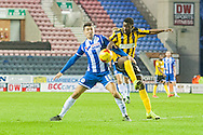Tim Chow of Wigan Athletic and Larnell Cole of Shrewsbury Town during the Sky Bet League 1 match at the DW Stadium, Wigan<br /> Picture by Matt Wilkinson/Focus Images Ltd 07814 960751<br /> 21/11/2015