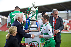 WREXHAM, WALES - Monday, May 2, 2016: FAW life vice president Phil Pritchard hands a winners medal to a The New Saints player during the 129th Welsh Cup Final at the Racecourse Ground. (Pic by David Rawcliffe/Propaganda)