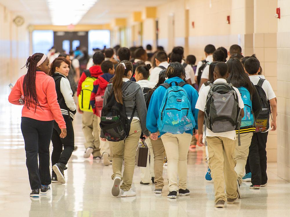Students walk down hallway at Ortiz Middle School, September 3, 2015.