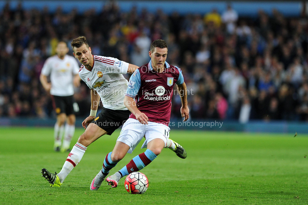 Jordan Veretout of Aston Villa &copy; goes past  Morgan Schneiderlin of Manchester Utd. Barclays Premier League match, Aston Villa v Manchester Utd at Villa Park in Birmingham, Midlands on Friday 14th August  2015.<br /> pic by Andrew Orchard, Andrew Orchard sports photography.