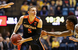 Dec 5, 2017; Morgantown, WV, USA; Virginia Cavaliers guard Kyle Guy (5) looks to pass during the first half against the West Virginia Mountaineers at WVU Coliseum. Mandatory Credit: Ben Queen-USA TODAY Sports