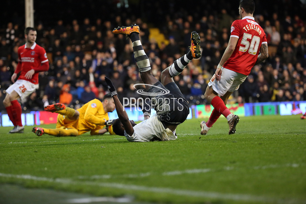 Fulham striker, Moussa Dembele (25) going down in the box during the Sky Bet Championship match between Fulham and Charlton Athletic at Craven Cottage, London, England on 20 February 2016. Photo by Matthew Redman.