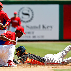 March 25, 2012; Clearwater, FL, USA; Baltimore Orioles second baseman Robert Andino (11) is caught stealing by Philadelphia Phillies shortstop Jimmy Rollins (11) during the top of the third inning of a spring training game at Bright House Networks Field. Mandatory Credit: Derick E. Hingle-US PRESSWIRE