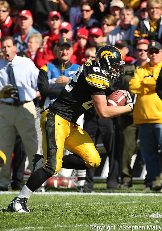 18 OCTOBER 2008: Iowa tight end Allen Reisner (82) runs 16 yards for a touchdown after making a catch in the second half of an NCAA college football game against Wisconsin, at Kinnick Stadium in Iowa City, Iowa on Saturday Oct. 18, 2008. Iowa won 38-16.