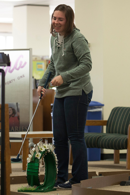 Natalie Heller laughs at the 18th hole during the Alden Open, a Dad's Weekend Mini-Golf event in Alden Library, on Saturday, November 7, 2015. Photo by Kaitlin Owens