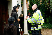 Josh, 26, (left) is arguing with a police officer (right) in regards to squatting rights, on the day owners of the luxurious 89 Winnington Road mansion came to check on the house and found the squatters inside, on Monday, Oct. 22, 2007 in Hampstead, London, England. On the back, the owners are waiting with a smile on their face, sure enough that the house will be made free again by using the police to their own interests instead of having to proceed to court for a repossession order, the standard practice when dealing with squatters if agreements cannot be made.  The mansion was former Indonesian President Haji Mohamed Suharto's top London mansion and was sold in 1999 for UK£ 9.5M when he was being investigated in his home country in regards to his fortune and extravagant lifestyle. Million Dollar Squatters is a documentary project in the lives of a peculiar group of squatters residing in three multi-million mansions in one of the classiest residential neighbourhoods of London, Hampstead Garden. The squatters' enthusiasm, their constant efforts to look after what has become their home, their ingenuity and adventurous spirit have all inspired me throughout the days and nights spent at their side. Between the fantasy world of exclusive Britain and the reality of squatting in London, I have been a witness to their unique story. While more than 100.000 properties in London still lay empty to this day, squatting provides a valid, and lawful alternative to paying Europe's most expensive rent prices, as well as offering the challenge of an adventurous lifestyle in the capital.