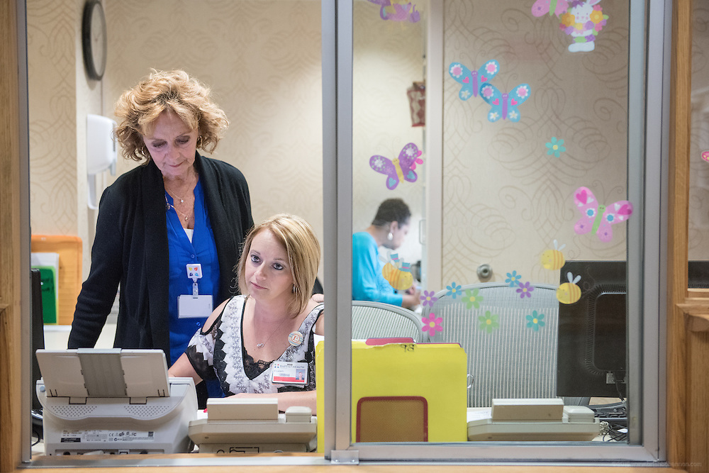 In the registration window are Lois Bickett, left, with Elizabeth Torez and Robbin Washington, photographed Thursday, May 21, 2015 at Baptist Health in Lexington, Ky. (Photo by Brian Bohannon/Videobred for Baptist Health)