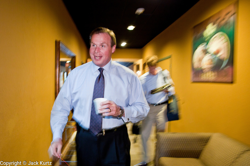 July 14 - PEORIA, AZ: JD HAYWORTH, a former Republican Congressman from Arizona, walks into a hotel lobby in Peoria, AZ, before addressing a Tea Party meeting there. Hayworth spoke to a Tea Party gathering in a hotel meeting room in Peoria. Hayworth, an ultra conservative, is running to the right of McCain in the Arizona Republican US Senate primary. He has painted McCain as a moderate to liberal Senator in the mold John Kerry (D-MA).     Photo by Jack Kurtz