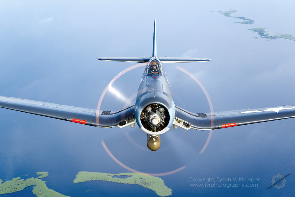John O'Conner flies his freshly restored FG-1D Corsair named 'Kathleen' behind Larry Kelley's B-25 'Panchito'. The Goodyear FG-1D Corsair N209TW was the Grand Champion recipient in the WWII category at EAA Airventure 2010.