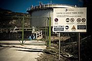 Corleto Perticara (PZ) 17.02.2009, Italy - Tempa Rossa - Speranze e realtà del giacimento Total in Basilicata. Il  giacimento petrolifero si estende in superficie per circa 30.000 ettari di terreno boschivo a nord-est dell'abitato, ampiamente sfruttato già dal 2001 nella produzione di energia eolica. Il 28 gennaio 2008 il comune di Corleto Perticara, nella persona del suo sindaco, avvocato Paolo Pietro Montano e Total Italia S.p.A. nella persona del suo amministratore delegato per il settore Esplorazione e Produzione, Dott. Lionel Levha, hanno siglato un Patto storico per la concessione dei diritti di superficie necessari alla realizzazione di un centro olio in località Tempa Rossa, a quattro Km in linea d'aria dal centro abitato, per un tempo pari a 99 anni. La coltivazione di idrocarburi, che a a pieno regime comporterà l'estrazione di 50.000 barili di greggio al giorno, gas naturale per 250.000 m2, GPL per 267 tonnellate e zolfo per 60 tonnellate, avrà inizio entro l'anno 2011. Le riserve sono stimate intorno ai 420 milioni di barili equivalenti. NELLA FOTO: Il Centro di Carico Tempa Rossa.
