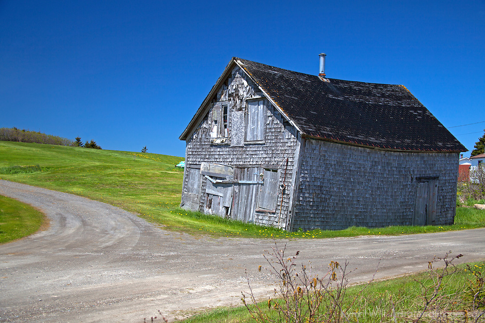 North America, Canada, Nova Scotia. Aged barn reflects charcter of the landscape and scenery of Nova Scotia.