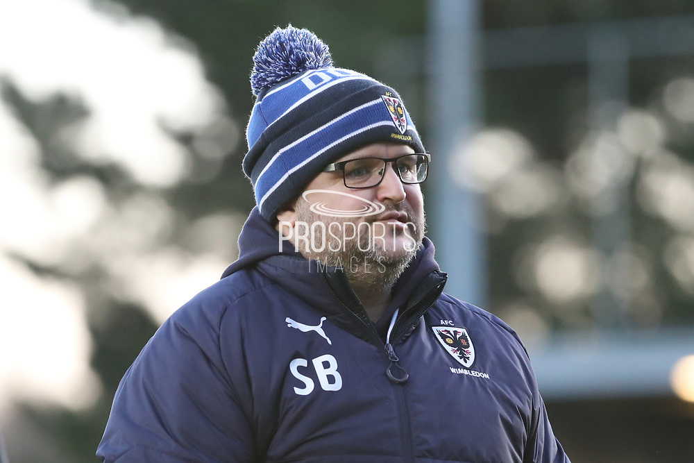 AFC Wimbledon first team coach Simon Bassey walking off the pitch during the EFL Sky Bet League 1 match between AFC Wimbledon and Southend United at the Cherry Red Records Stadium, Kingston, England on 1 January 2018. Photo by Matthew Redman.