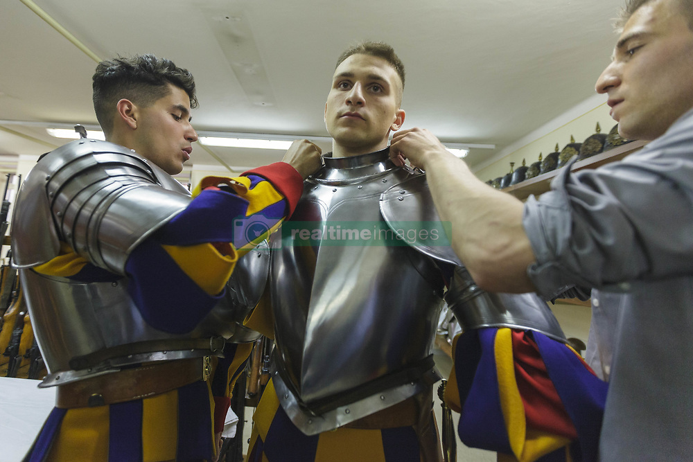 May 6, 2017 - Vatican City, Vatican - New Vatican Swiss Guards wear their uniforms and armors prior to a swearing in ceremony for the new 40 Swiss Guards recruits in San Damaso Courtyard in Vatican City, Vatican. The annual swearing in ceremony, to protect pope Francis and his successors, for the new papal Swiss Guards takes place on May 6 commemorating the 147 soldiers of the Corps who died defending Pope Clement VII during the assault of the Lanzichenecchi mercenaries, the Sack of Rome, on May 6th 1527. (Credit Image: © Giuseppe Ciccia/Pacific Press via ZUMA Wire)