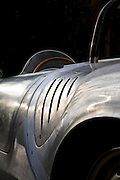 Image of a silver 1950s Porsche 550A Spyder close up