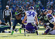 Seattle Seahawks running back, Marshawn Lynch charges down the field against the Minnesota Vikings. Seattle beat Minnesota 41-20. Photo by John Lill.