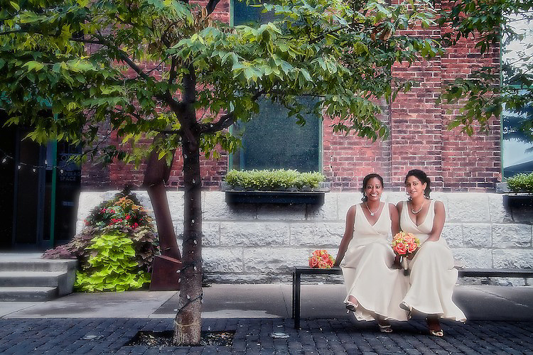 Two sisters and cousins of the bride pose for a portrait at the Distillery District, Toronto. To view Myriam and Cory's complete Wedding Gallery Collection, please visit the Client Area and log-in. You'll be able to view these and other images as a slideshow, order prints and more.<br /> <br /> &copy; Images of a Promise by Dean Oros Photo + Design