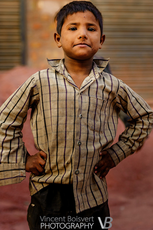 a proud looking young boy in bikaner market, India