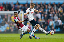 Eric Dier of Tottenham Hotspur is tackled by Jordan Ayew of Aston Villa - Mandatory byline: Rogan Thomson/JMP - 13/03/2016 - FOOTBALL - Villa Park Stadium - Birmingham, England - Aston Villa v Tottenham Hotspur - Barclays Premier League.