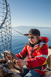 """Boy Fishing Lake Tahoe"" - This boy was photographed fishing on Lake Tahoe from a boat."