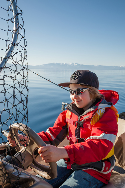 """""""Boy Fishing Lake Tahoe"""" - This boy was photographed fishing on Lake Tahoe from a boat."""