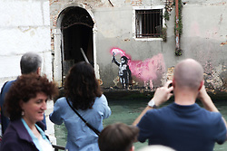 Italy, Venice - May 26, 2019.Steet mural by Banksy..The British street artist has confirmed the mural of a migrant child holding a pink flare in Venice (Credit Image: © Chiara Toniolo/Ropi via ZUMA Press)