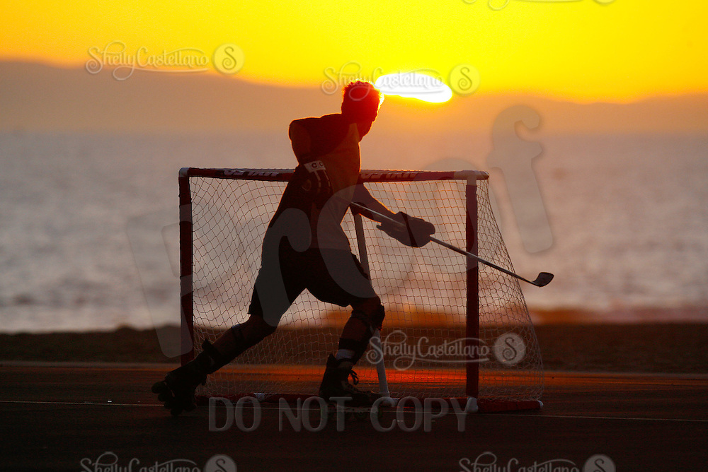 22 January 2011:  PBHA outdoor roller hockey sunset on the blacktop at the beach.  David Golini.