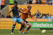 Wolverhampton Wanderers striker Joe Mason tackles Wolverhampton Wanderers midfielder George Saville  during the Sky Bet Championship match between Wolverhampton Wanderers and Sheffield Wednesday at Molineux, Wolverhampton, England on 7 May 2016. Photo by Alan Franklin.